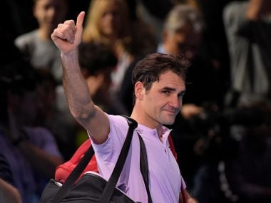 Roger Federer salutes the fans as he leaves the court after losing against David Goffin. Reuters