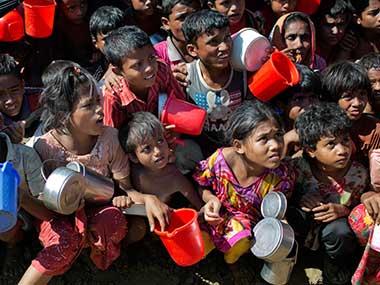 Rohingya Muslim children wait to receive food handouts at Thaingkhali refugee camp in Bangladesh. AP