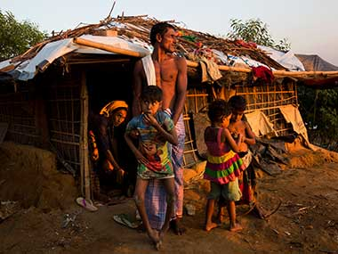 A newly arrived Rohingya family settles in at Kutupalong refugee camp, Bangladesh. AP