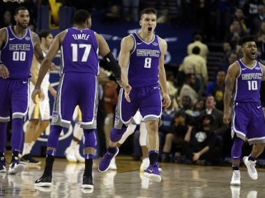 Sacramento Kings' Bogdan Bogdanovic (second from right) celebrates after scoring in the final seconds against the Golden State Warriors. AP