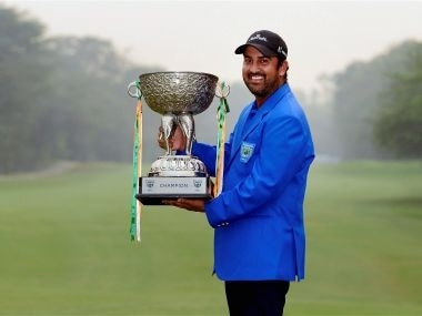 Shiv Kapur poses with the trophy after winning the Panasonic Open in New Delhi. PTI