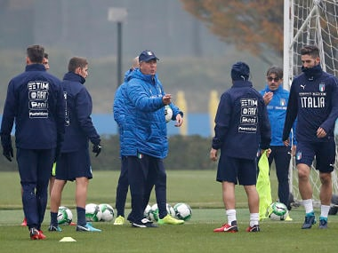 Italy coach Gian Piero Ventura, third from left, gives instructions to his players during a training session ahead of Monday's World Cup qualifying play-off return leg soccer match against Sweden, in Appiano Gentile, near Milan, Italy, Sunday, Nov. 12, 2017. (AP Photo/Antonio Calanni)