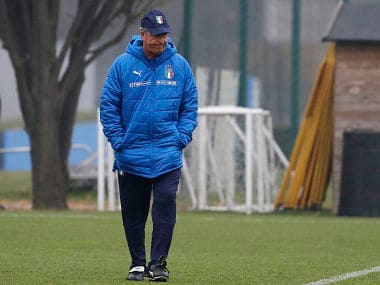 Italy coach Gian Piero Ventura walks on the pitch during a training session ahead of Monday's World Cup qualifying play-off return leg soccer match against Sweden, in Appiano Gentile, near Milan, Italy, Sunday, Nov. 12, 2017. (AP Photo/Antonio Calanni)