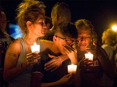 Locals hold a candlelight vigil for the victims of a fatal shooting at the First Baptist Church of Sutherland Springs. AP