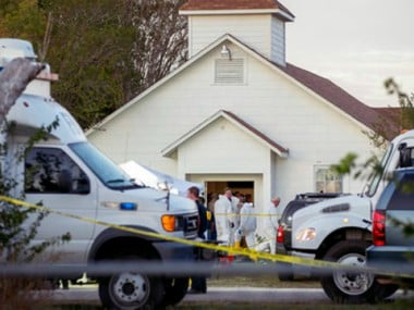 Investigators work at the scene of a deadly shooting at the First Baptist Church in Sutherland Springs, Texas. AP