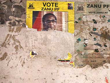 Part of an election poster from the 2008 Zanu Pf election campaign is seen the wall of a dilapidated building in the Mbara suburb of Harare in Zimbabwe. AP