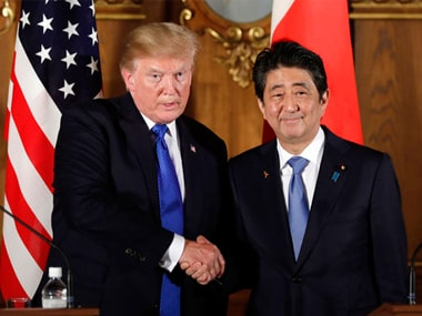 President Donald Trump, left, shakes hands with Japanese Prime Minister Shinzo Abe during a joint news conference on Monday. AP