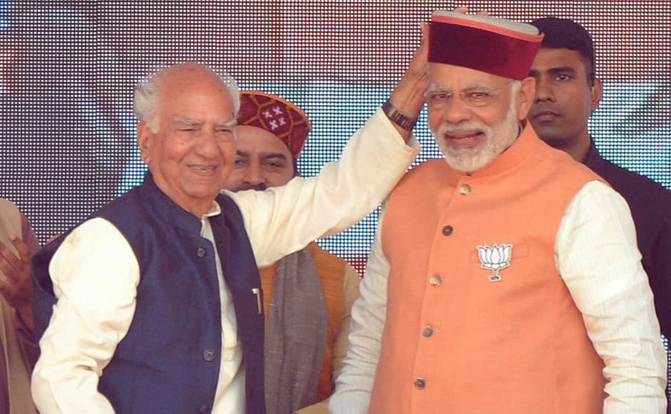Prime Minister Narendra Modi with party senior leader and MP Shanta Kumar during an election rally at Palampur on Sunday. Modi conducted mega rallies in the poll-bound regions of Una, Palampur and Kullu. PTI
