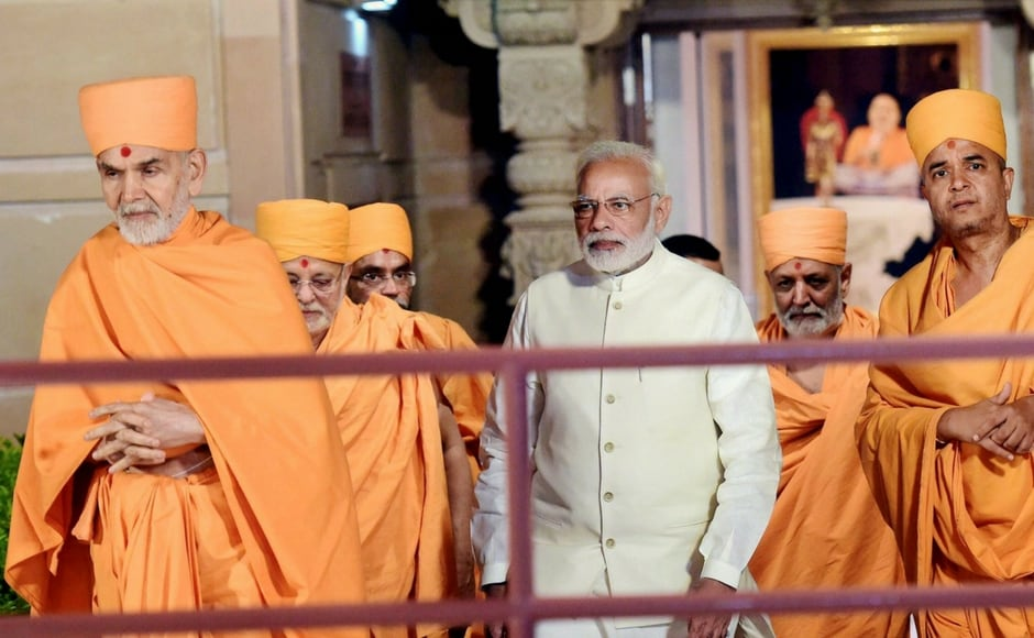 "Modi remembered Pramukh Swami Ji Maharaj, the guru and head of Swaminarayan Sanstha and praised him for bringing in ""modern managment"" in BAPS while keeping the Indian tradition alive. PTI"