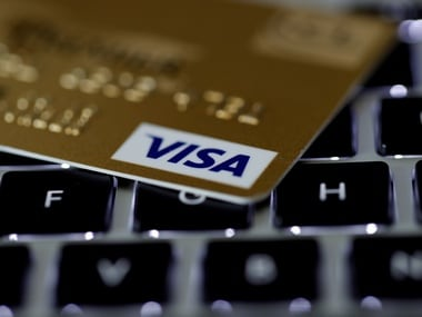 A Visa credit card is seen on a computer keyboard. Reuters.