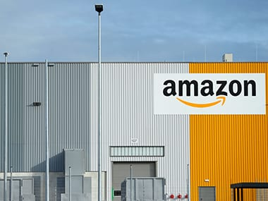 Amazon reports largest ever profit of $2 billion as its shares rise by more than 6 percent
