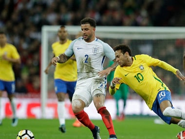 England's Kyle Walker and Brazil's Neymar challenge for the ball during the international friendly at Wembley. AP
