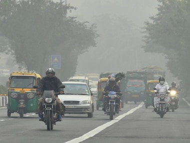 People commute during the foggy in New Delhi on Saturday. PTI