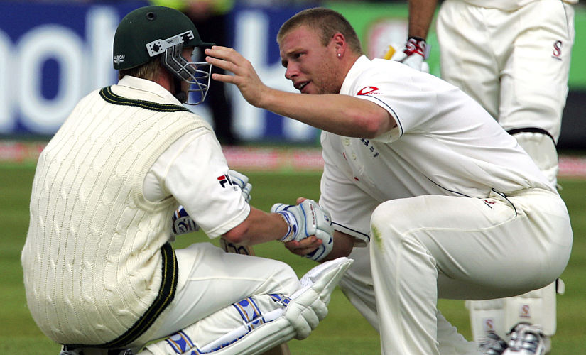 England's Andrew Flintoff consoles Australian Brett Lee after England beat Australia by just two runs to win the Second Test at Edgbaston cricket ground in Birmingham in 2005. AFP