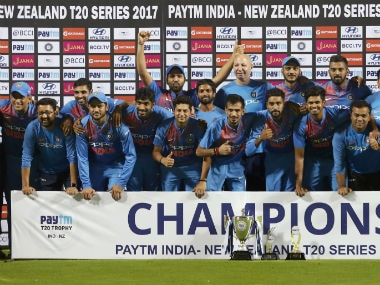 Members of Indian cricket team pose with the winners trophy after their win in the 3rd T20I against New Zealand in Thiruvananthapuram. AP