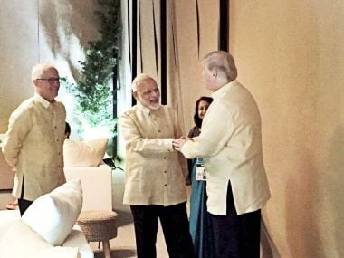 Prime Minister Narendra Modi shakes hands with US President Donald Trump during a meeting in Manila on Sunday. PTI