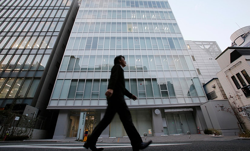 A man walks past a building where Mt. Gox, a digital marketplace operator, is housed in Tokyo February 25, 2014. The website of Mt. Gox appears to be taken down, shortly after six major Bitcoin exchanges released a joint statement distancing themselves from the troubled Tokyo-based bitcoin exchange. Tokyo-based Mt. Gox was a founding member and one of the three elected industry representatives on the board of the Bitcoin Foundation. REUTERS/Toru Hanai (JAPAN - Tags: BUSINESS CIVIL UNREST SCIENCE TECHNOLOGY) - GM1EA2P1EFK01