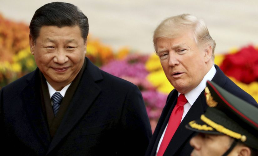 US President Donald Trump and Chinese leader Xi Jinping participate in a welcome ceremony at the Great Hall of the People on Thursday. AP