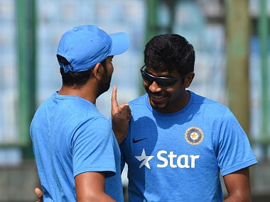 India's Jasprit Bumrah (R) shares a light moment with Rohit Sharma during a training session at the Ferozshah Kotla stadium in New Delhi on October 19, 2016, on the eve of the second One Day International (ODI) cricket match between India and New Zealand. --- GETTYOUT --- IMAGE RESTRICTED TO EDITORIAL USE --- STRICTLY NO COMMERCIAL USE --- / AFP PHOTO / PRAKASH SINGH / ----IMAGE RESTRICTED TO EDITORIAL USE - STRICTLY NO COMMERCIAL USE----- / GETTYOUT