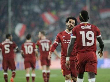 Liverpool's Senegalese midfielder Sadio Mane (R) celebrates with Liverpool's Egyptian midfielder Mohamed Salah (L) after scoring a goal on November 21, 2017 at the Ramon Sanchez Pizjuan stadium in Sevilla during the UEFA Champions League group E football match between Sevilla FC and Liverpool FC. / AFP PHOTO / CRISTINA QUICLER