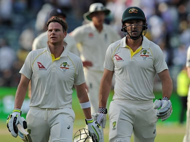Steve Smith and Shaun Marsh leave the field at the end of day two of the third Ashes Test. AFP