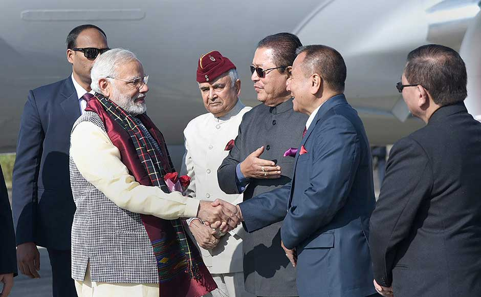 The prime minister was in the two states during his day-long visit to the North East on Saturday. Modi being greeted by the Governor of Mizoram, Nirbhay Sharma and Chief Minister of Mizoram Pu Lalthanhawla on his arrival at Aizawl. PTI