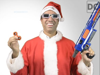Ajit Pai prances around in a Santa suit as he explains his take on net neutrality. Image: The Daily Caller