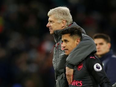 File image of Arsenal manager Arsene Wenger with Alexis Sanchez. Reuters