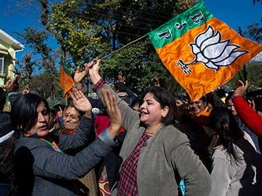 BJP supporters in Himachal Pradesh celebrate after their candidate's victory outside a poll counting center. AP