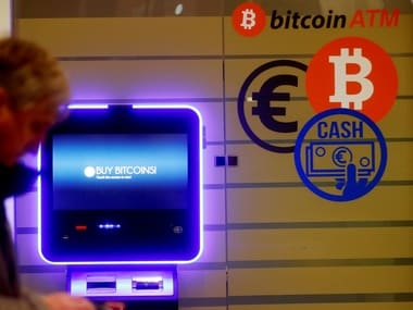 A man walks past a bitcoin ATM in Vilnius, Lithuania. Image: Reuters