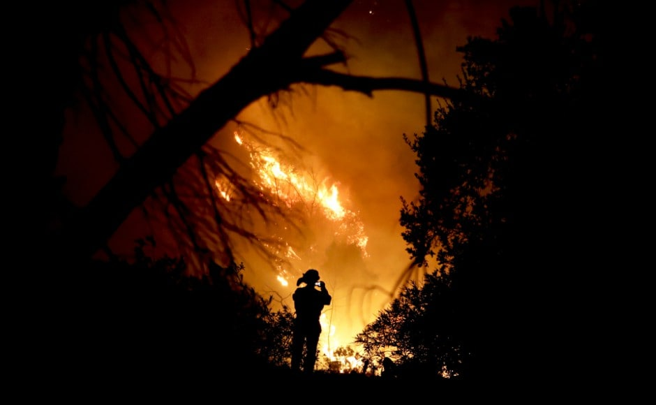 Ferocious California wildfire grows into third-largest in state history as winds pick up