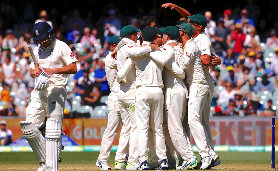 Australia's Mitchell Starc celebrates with teammates after bowling England's Jonny Bairstow to win the second Ashes Test match. Australia won the Adelaide Test by 120 runs on Day 5, with Josh Hazlewood striking twice in the first three overs and Starc finishing off the tail. Reuters