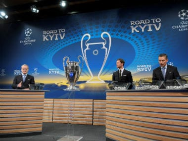 EFA director of competitions Giorgio Marchetti, Spanish former international Xabi Alonso and UEFA head of club competitions Michael Heselschwerdt take part in the draw for the round of 16 of the UEFA Champions League football tournament at the UEFA headquarters in Nyon. AFP