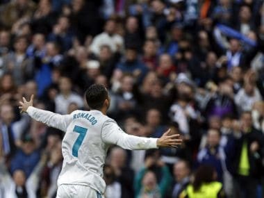 Real Madrid's Cristiano Ronaldo celebrates after scoring his side's second goal against Sevilla. AP