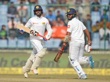 Sri Lanka batsman Dhananjaya De Silva (L) and Roshen Silva run between the wickets during the third Test match against India. AFP