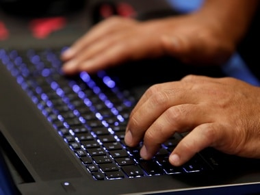 A man types into a keyboard during the Def Con hacker convention in US. Image: Reuters