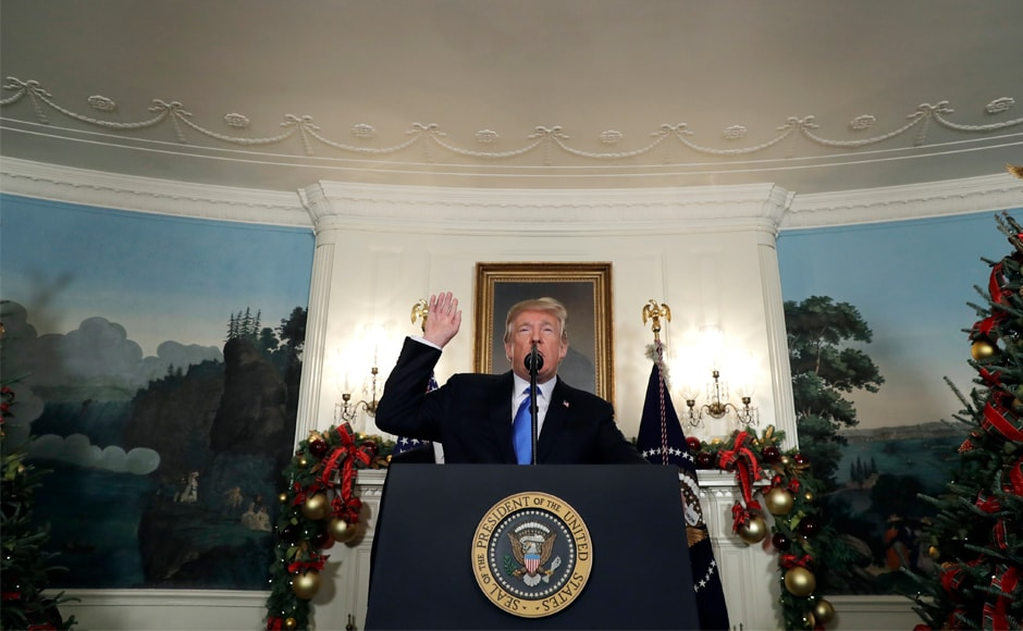 """We cannot solve our problems by making the same failed assumptions and repeating the same failed strategies of the past,"" Trump said, brushing aside the appeals for caution from around the world. AP"