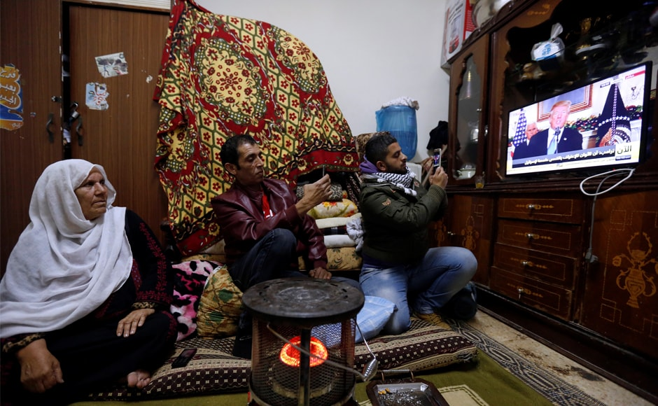 A Palestinian refugee family watches a televised broadcast of the announcement, at a refugee camp, near Amman in Jordan. Trump's announcement sparked protests across the Arab world with Palestine president Mahmoud Abbas saying it signalled US withdrawal from being a peace mediator. Reuters