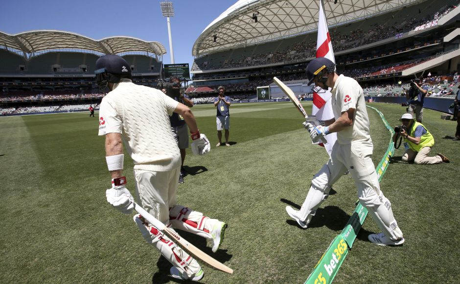 England's batsmen Joe Root, right, and Chris Woakes walk on for the start of the fifth day of their Ashes Test match against Australia in Adelaide. England, with six wickets in hand, needed 178 runs to win when Day 5 started. AP