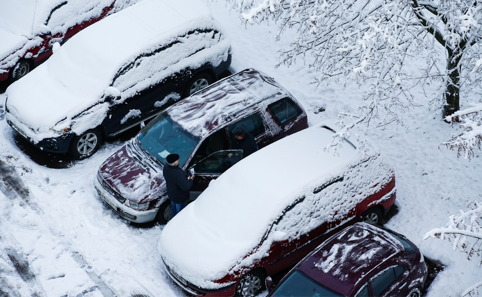 Snow envelopes parked cars in Minsk, Belarus. Power was also cut in several parts of Europe due to gale-force winds. Reuters