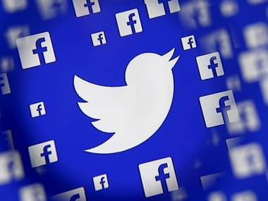 Logo of the Twitter and Facebook are seen through a magnifier. Image: Reuters