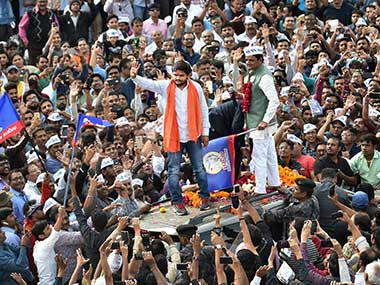 Patidar community leader Hardik Patel waves at supporters during a road show for the second phase of state assembly elections, in Ahmedabad. PTI
