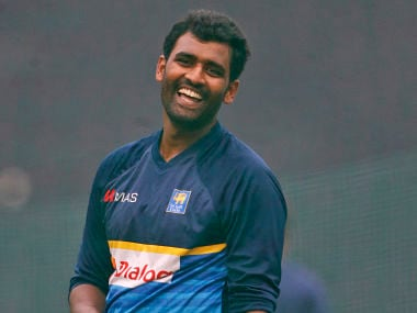 Sri Lanka's captain Thisara Perera smiles while bowling at nets during a practice session ahead of their second one-day international cricket match against India in Mohali, India, Tuesday, Dec. 12, 2017. (AP Photo/Altaf Qadri)