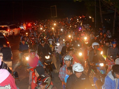 Motorists are stuck in traffic as they try to reach higher ground amid fears of a tsunami in Indonesia. AP