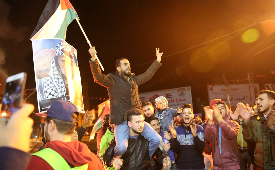 Palestinian protestors chanted slogans as they waivedtheir national flags and pictures of Arafat during a protest at the main square in Gaza City on Wednesday. Trump upended decades of US policy in defiance of warnings from around the world that the gesture risks aggravating conflict in the tinderbox West Asia.
