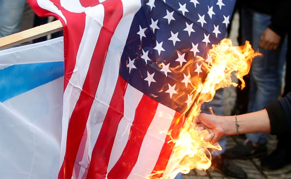 Palestinian demonstrators burnt a US flag during a protest in Gaza City. Jerusalem's eastern sector was captured by Israel in a 1967 war and annexed in a move not recognised internationally. Palestinians claim East Jerusalem for the capital of an independent state they seek. Reuters