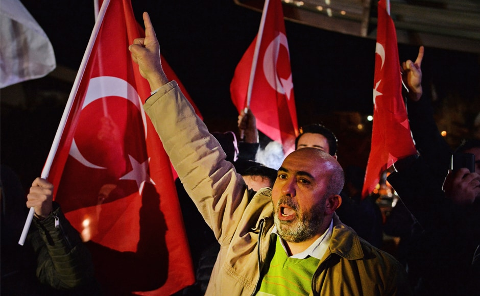 Protests also spread to Turkey where demonstrators, some holding Turkey's flags, chant anti-US slogans during a demonstration near the US embassy in Ankara. AP