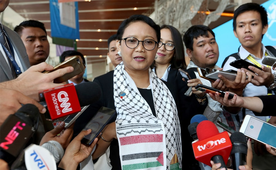 Wearing a Palestinian scarf, Indonesian foreign minister Retno Marsudi condemned US' decision at the Bali Democracy Forum held in Tangerang on the outskirts of Jakarta. AP