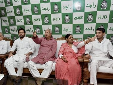 File image of RJD chief Lalu Prasad Yadav with wife Rabri Devi, son Tejaswi Yadav and Tej Pratap. PTI