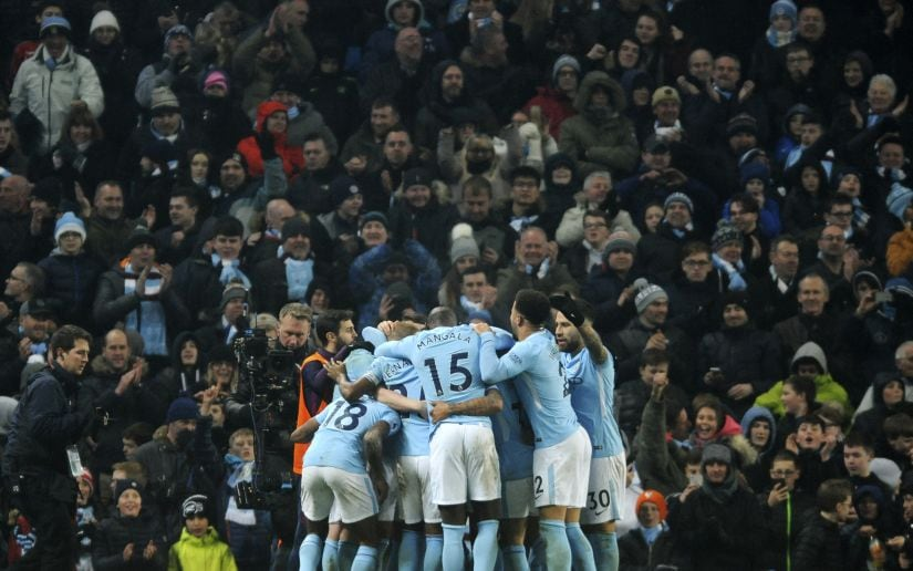 Manchester City players celebrate their team's third goal during the match against Tottenham Hotspur. AP